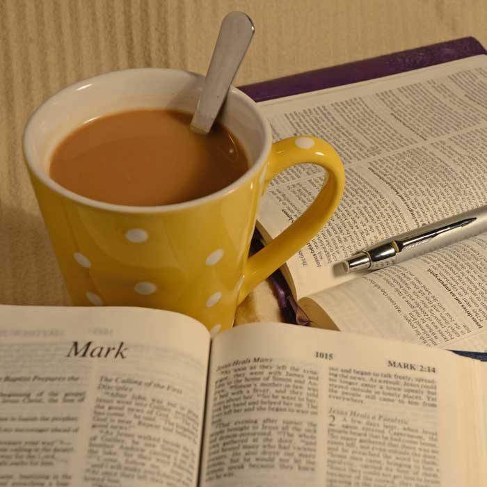 Bibles with coffee cup